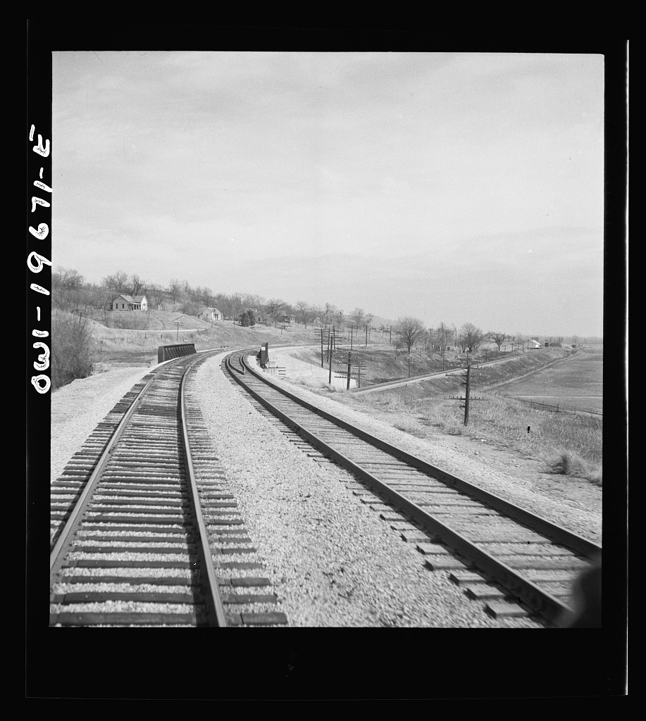 [Camden, Missouri. Looking east on the Atchison, Topeka, and Santa Fe Railroad where it crosses over the Wabash Railroad tracks]