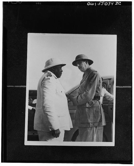 Charles de Gaulle, chief of the Free France, is welcomed to Chad by Govenor-General Eboue of Free French Africa. Governor-General Eboue, a native of French Guinea, was the first Negro colonial governor in Africa. As governor of the Chad colony, he was the first African leader to rally to the Free French cause