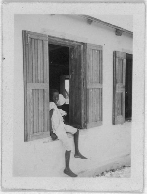 [Child sitting in window, possibly from the visit by Alan Lomax and Mary Elizabeth Barnicle to Andros Island in the Bahamas]