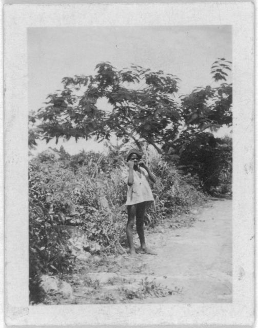 [Child standing, facing front, possibly from the visit by Alan Lomax and Mary Elizabeth Barnicle to Andros Island in the Bahamas]