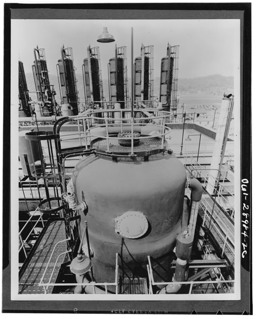 Conversion. A converter at one of the four butadiene units at the Institute plant at Institute, West Virginia, where the processing of grain alcohol to butadiene is started. The distillation towers are shown in the background