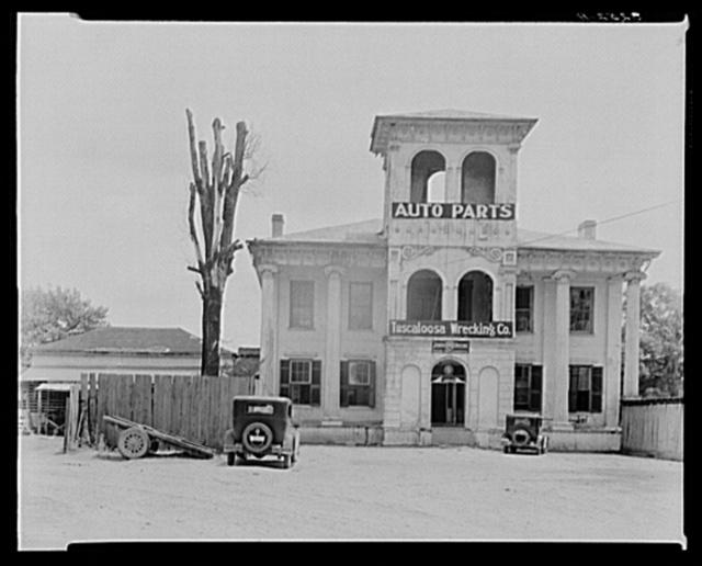 Converted antebellum residence into Tuscaloosa Wrecking Company and Auto Parts. Alabama