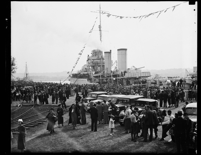 Crowd at Navy Day fete. Huge crowds crammed the Navy Yard as the Navy went on show for the Navy Day celebration. This picture shows the U.S.S. Dale, the largest type destroyer in the service. 10/28/35