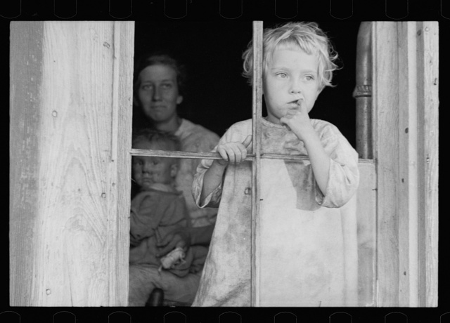 Daughter of sharecropper, Wilmington, North Carolina. Mother and another child in background