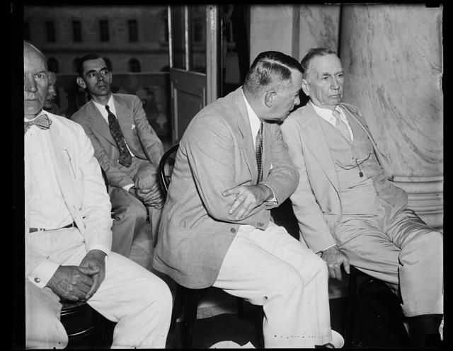 """Defendants. Joseph Weaver, left, head of the Bureau of Navigation and Steamboat Inspection, and Secretary of Commerce Daniel C. Roper, photographed at the Senate Commerce committee where Ewing Y. Mitchell, ousted assistant Secretary of Commerce, charged that steamboat inspectors accepted """"gratuities"""" from ship operators. He alleged """"graft,"""" 6/21/35"""