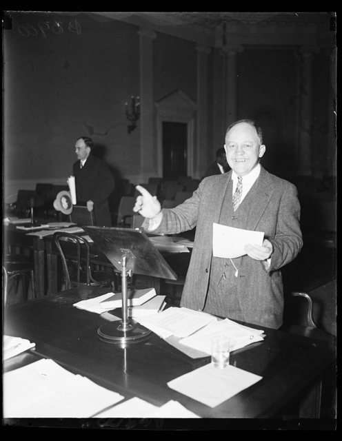 Economic Security Director. Edwin E. Witte, Executive Director of the Presidential Committee on Economic Security, explains the old age pension proposal of the president to the Ways and Means Committee of the House, 1/21/35
