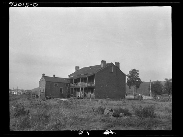 "Eleanor, West Virginia. Rear view of administration building at Red House after which Red House Farms was named. The ""Red House"" was built of brick prior to 1825 by Joseph Ruffuer"