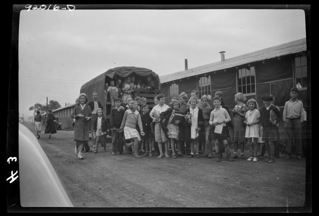 Eleanor, West Virginia. Two hundred forty-four children attend the grade school of the Red House farms project barracks, supervised by eight teachers furnished by the county. Grade children are transported in the project trucks