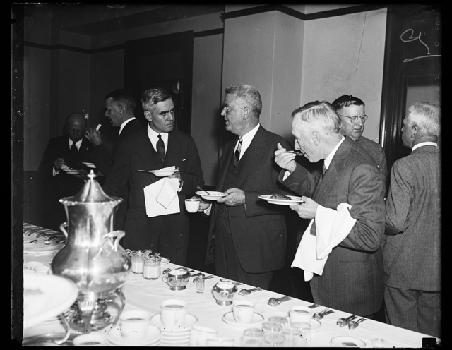 """Explaining New Deal. From the left, W. Dale Clark of Omaha; Lyman E. Wakefield, of Minneapolis, and Thomas R. Preston, Chattanooga, all directors of the U.S. Chamber of Commerce, photographed at the luncheon which interrupted the """"explaining"""" of the New Deal by Chamber Directors. It was emphasized that the Directors were not """"denouncing"""" the New Deal, merely """"explaining"""""""