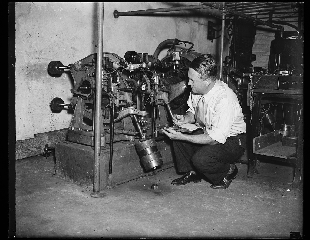Fighting highway deaths, Wash. D.C. This photograph shows Richard S. Dill, a worker in the U.S. Bureau of Standards, tabulating the efficiency of various kinds of brake linings as the government attempts to determine the best for use on its vehicles. The automobile industry is watching these tests carefully as a possible indication of the kind of brake lining to use to reduce the number of deaths on highways, which numbered 33,980 in 1934, 10/4/35