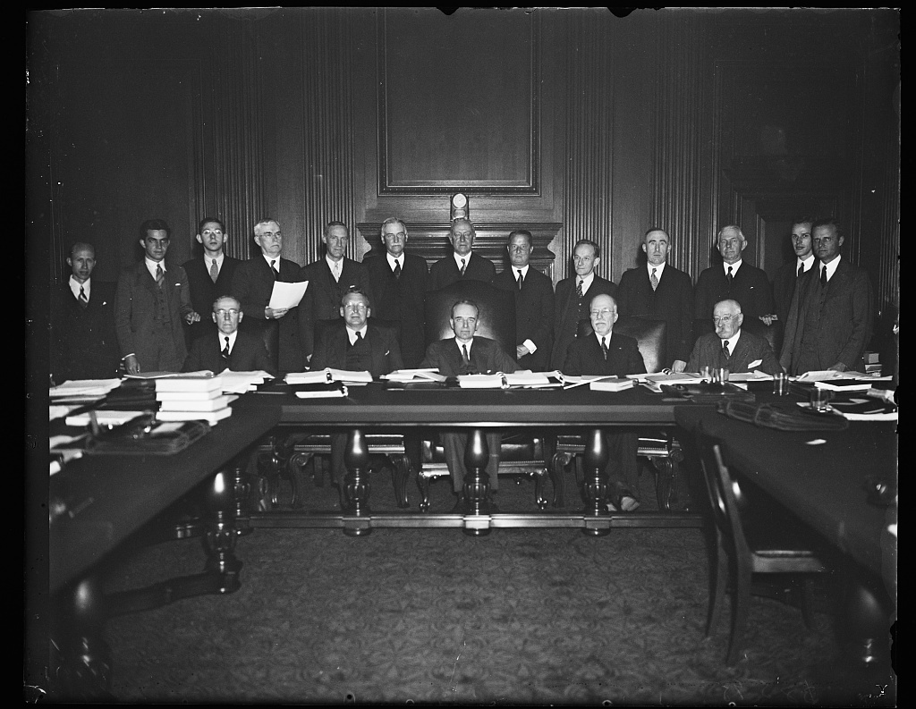 First exclusive picture in new Supreme Court building. Members of the United States Supreme Court Advisory Committee on rules of Civil Procedure in an exclusive Harris & Ewing photograph which was the first to be made of any legal group in the new Court building. The committee is working out a uniform set of rules to be used in district courts to so as to secure one form of procedure. From the left, seated: Edison R. Sunderland, U. of Mich.; Chas. E. Clark. Yale; Wm. D. Mitchell, former attorney general; Edgar B. Colman, Spl. Ass't Att. Gen/; George W. Wickersham, former Attorney Gen. (Standing), L to R: James Moore, clerk; Ferdinand Stone. Edward C. Jaegerman, both clerks; Geo. Donworth, Seattle; A.M. Dobie, Virginia Law School; Warren Olney, Jr., San Francisco; Robt. G. Dodge, Boston; Monte N. Lee Lemman, New Orleans; Edmund M. Morgen, Harvard; Wilbur H. Cherry, Minn.; S.M. Loftin, former Bar Assn. Pres. [...]