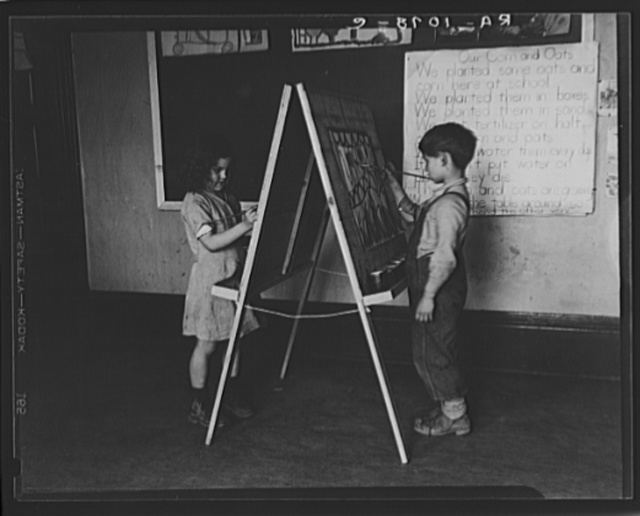 First grade boy and girl at drawing board in schoolroom. Reedsville, West Virginia