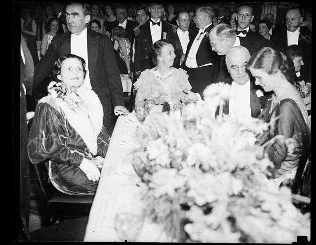FIRST LADY AT DANCE. MRS. ROOSEVELT, AT LEFT, AND HER PARTY AS THEY ATTENDED THE PRESIDENT ROOSEVELT BIRTHDAY BALL AT THE SHOREHAM HOTEL. FROM THE LEFT: MRS. ROOSEVELT; ASSISTANT SECRETARY OF THE NAVY HENRY L. ROOSEVELT; RAY BAKER, CHAIRMAN OF THE BALLADOR OSWALDO ARANHA, CENTER, AND PRESIDENT ROOSEVELT COMPLETED THE PICTURE