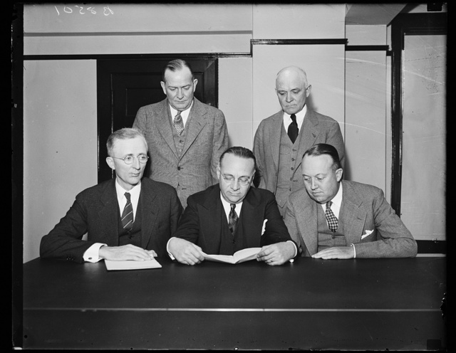 "First picture of Coal Commission. This is the first picture showing all five members of the Bituminous Coal Commission. Chairman Charles F. Hosford, Jr., issued a statement, a few minutes before the picture was made, that the group ""deplored"" efforts to stampede coal producers into refusing to come under the new Guffey Coal Act."" From the left: seated, Walter H. Maloney, Chairman Nosford, and George F. Acret. Standing, C.F. Smith, left, and Percy Tetlow, 10/25/35"