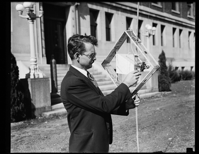 Gathering meteorological data from stratosphere. Dr. L.F. Curtiss, of the U.S. Bureau of Standards, is shown here with part of the equipment he uses in experiments using radio to gather meteorological data at great altitudes. The complete radio apparatus for attachment to a balloon weighs less than two pounds, and preliminary trials show that the signals can be heard clearly at altitudes of 14 miles and at distances of 80 miles. A direction finder [...]bles experimenters to determine the location [...] he balloon the instant the radio wave is [...] out. 10/17/35