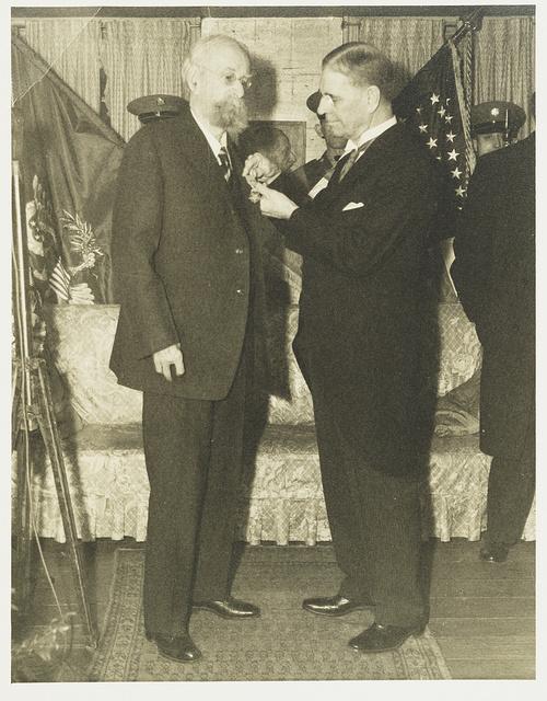 General A. W. Greely receiving the congression[al] medal from Secretary of War Kern [i.e., George Dern] at 2121 O St., Washington 7, D.C.