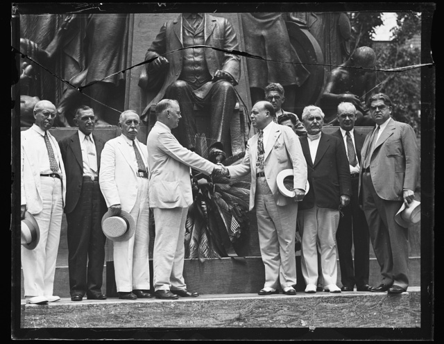 [Group in front of Samuel Gompers memorial: Santiago Iglesias, Resident Commissioner of Puerto Rico, 3rd from left, William Green, center, facing right, and John L. Lewis, right]