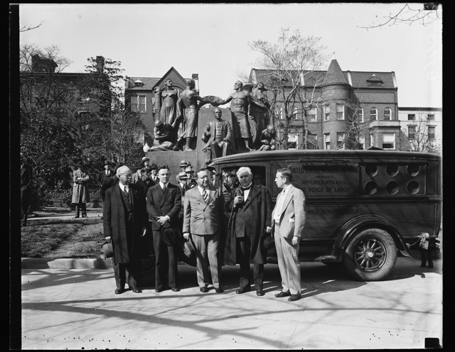 [Group with United Textile Workers of America truck in front of Samuel Gompers Memorial, Washington, D.C.]
