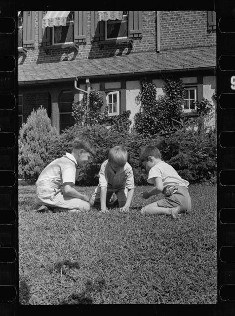 Healthy children at play on the front lawn of one of Washington's better housing sections. These houses have both sweeping front lawns and clean backyards
