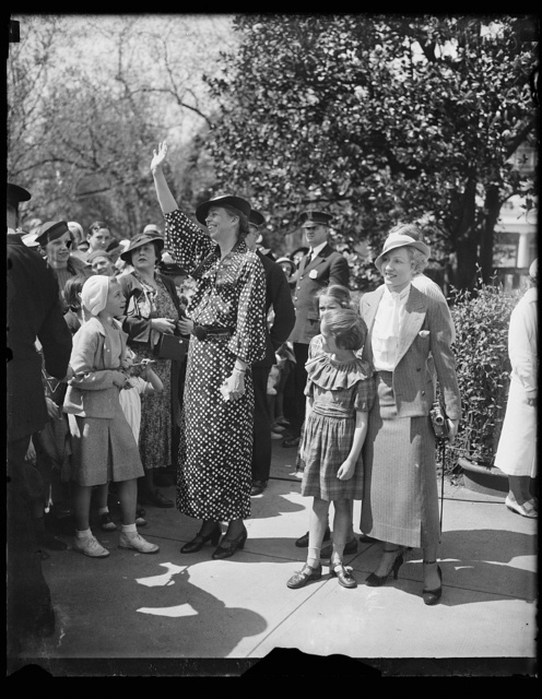 HERE'S THE HOSTESS. MRS. FRANKLIN D. ROOSEVELT, IN A BRIGHT NEW SPRING DRESS, MINGLES WITH THE THOUSANDS OF CHILDREN WHICH ARE HER GUESTS AT THE ANNUAL EGG ROLLING ON THE WHITE HOUSE LAWN FOLLOWING EASTER SUNDAY. IN THE PICTURE, FROM THE LEFT: MRS. FRANKLIN D. ROOSEVELT; AMY AND DIANA ROOSEVELT, DAUGHTERS OF MRS. J. HALL ROOSEVELT OF DETROIT; AND MAYRIS CHANEY OF NEW YORK CITY