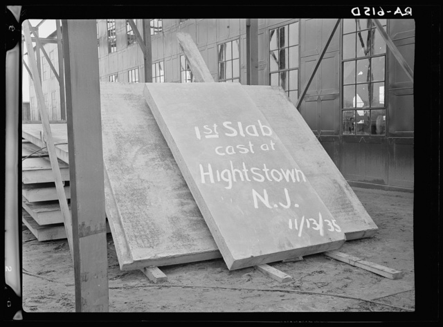 Hightstown, New Jersey. First concrete slab cast at Jersey Homesteads, a U.S. Resettlement Administration subsistence homestead project. Slabs of this type are to be used in the construction of houses on this project