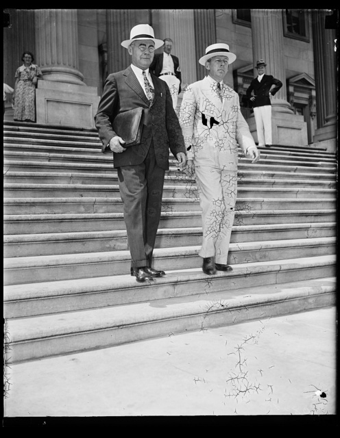 Hill leaves Senate. William A. Hill, Boston, Attorney for the utility king, Howard C. Hopson, leaves the Senate side of the Capitol with his counsel, Moultrie Hitt, Washington attorney, where Hill appeared in response to a citation for contempt growing out of the activities of Hopson, who is wanted by the Senate Lobby Investigating committee, 8/15/35