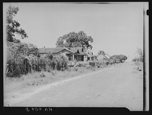 Homes of laborers on one of the large abandoned sugarcane plantations. These men are now on relief. Placquemines Parish, Louisiana