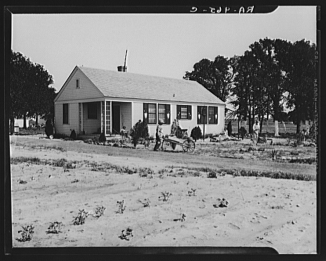 Homesteaders at work in front of their new house. Dallas, Texas