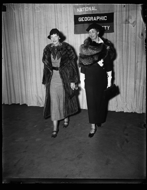 IMPORTANT WOMEN. AMELIA EARHART, FAMOUS FLIER, LEFT, AND MRS. FRANKLIN ROOSEVELT PHOTOGRAPHED AS THEY APPROACHED THE NATIONAL GEOGRAPHIC SOCIETY WHERE THE CONQUORER OF THE ATLANTIC AND THE PACIFIC BY AIR ADDRESSED THE MEMBERS