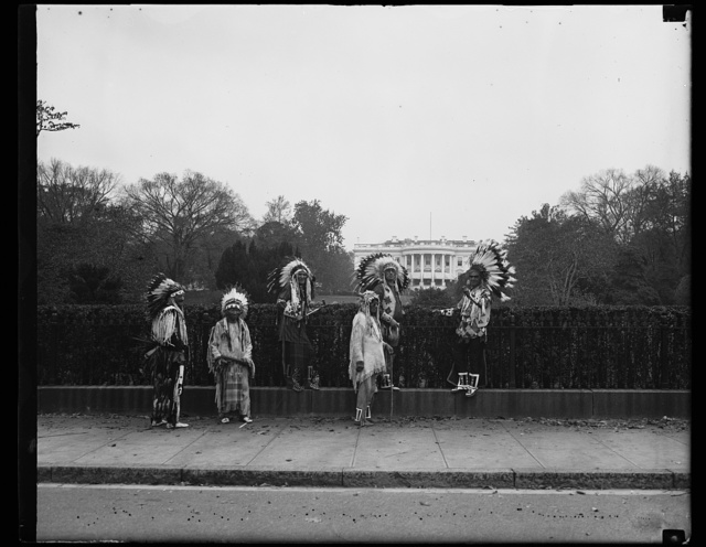 Indians view white fathers home in Washington. Leaders of the tribes on the Flathead Indian Reservation of Western Montana take a look at the White House as they visit Washington to be the first tribe to submit a constitution under the terms of the Wheeler-Howard Act. Although these indians are from the Flathead Reservation, they represent the Salish and Kootenai tribes. There have been no Flathead Indians for many years, 10/31/35