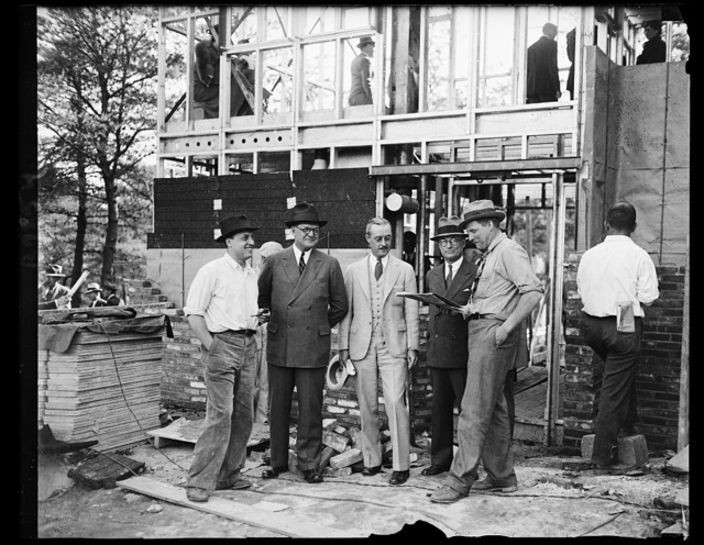 Inspecting Steel Houses. This group of steel men and architects inspect one of the partially completed fabricated steel houses being put up near Bethesda, Md. From the left: N.J. Clarke, Vice President, Republic Steel; L.S. Hamaker, Vice President, Berger Mgf. Co., Republic Steel subsidary; Oscar Stonorov, Phila., Architect; Tom M. Girdler, Chairman of the Republic Steel Corp. Board, and Alfred Kastner, Phila. Architect, 5/16/35