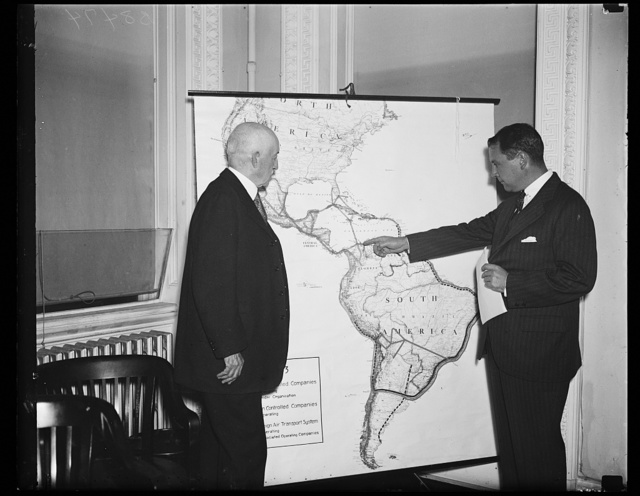 International Air Path Conference. R. Walton Moore, Assistant Secretary of State, left, and Juan T. Trippe, President of Pan-American Airways, studying International routes for airplanes. A meeting was held to recommend methods of promoting and preserving American interests in international air lanes. 10/31/35