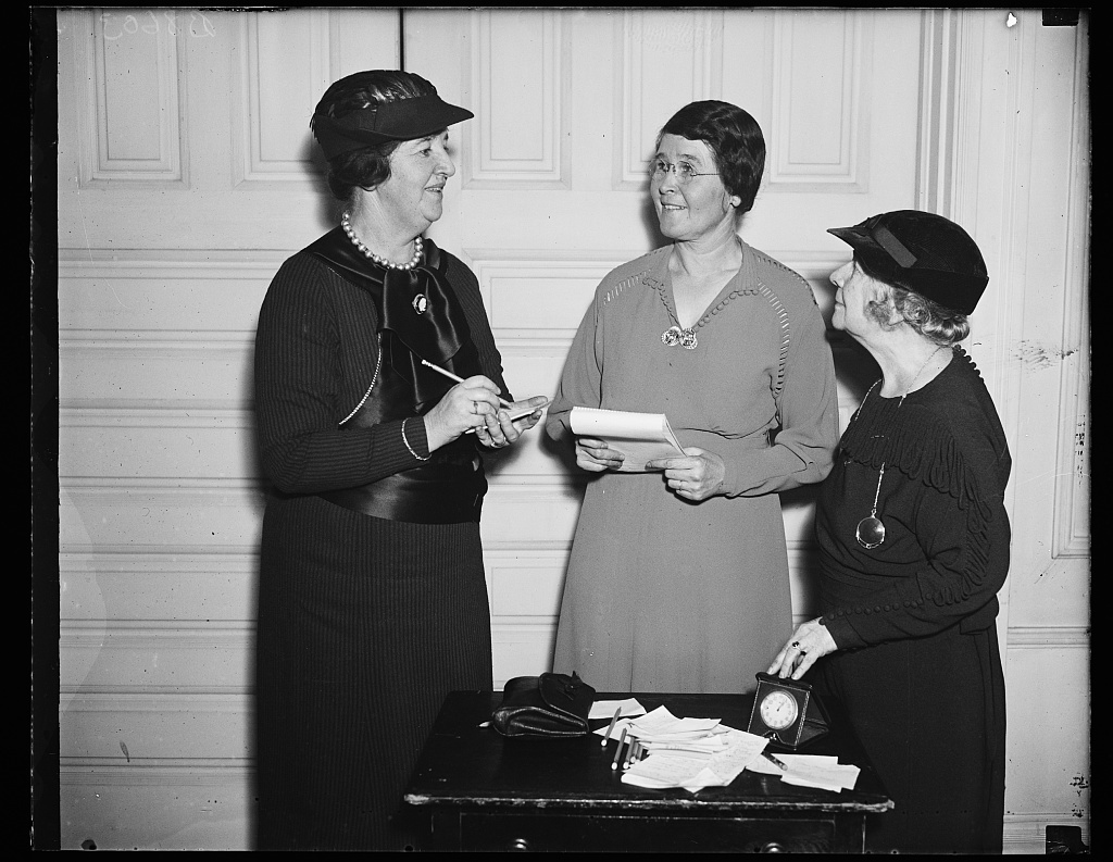 Jaw bone doggling, Wash. D.C. These Democratic party leaders are forming an army of political amazons to go out into the field and fight for the retention of the present administration at the next presidential election. Mrs. Hugh Butler, center, wife of the Commercial Attache at the U.S. Embassy at London, is instructor in a special course of political public speaking. On the left is Mrs. Samuel Herrick, chairman of the Public Speaking program of the Women's division of the National Democratic party, and on the right is Mrs. George M. Eckels, vice president of the Women's National Democratic club, 11/26/35