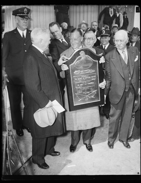 "[John Nance Garner, left; plaque: ""Presented by the people of Daytona Beach to Sir Malcolm Campbell ...]"