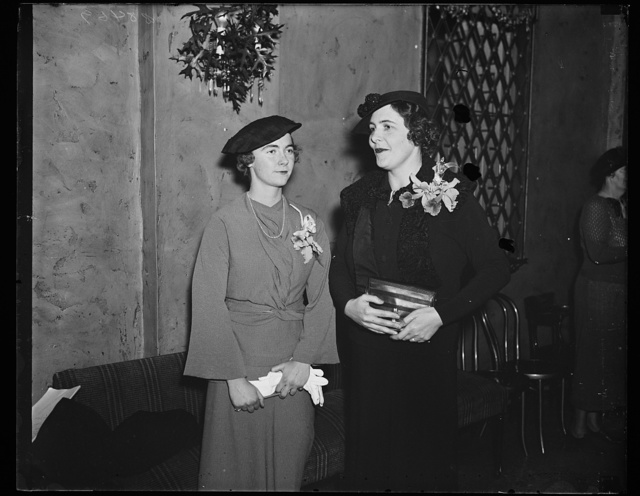 Junior League luncheon. Miss Anne Carter Green, left, president of the Junior League of Washington, and Mrs. Robert F. Dingman, New York City, representing the Association of Junior Leagues of America, photographed at the League luncheon which launches the new program of welfare work for the coming year. 11/1/35