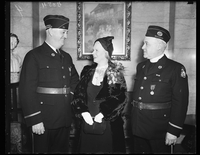 Leaders of the Legion. These leaders of the American Legion and its auxiliary photographed in Washington where they took leading parts in the Armistice Day ceremonies. From the left: Ray Murphy, National Commander; Mrs. Melville Mucklestone, National Pressident of the Auxiliary, and the Rev. Father Thomas D. Kennedy, National Chaplain of the Legion. 11/11/35