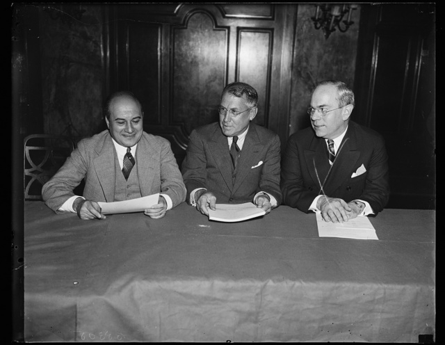 Liberty league lawyers. A report on the (un)constitutionality of the Wagner Labor Relations Act discussed by this group of lawyers of the American Liberty League. From the left: R.E. Desvernine, Chairman of the Lawyers comm.; Jouett Schouse and Earl F. Reed. 9/18/35