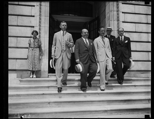 Looks like the wind-up. These principles in the Howard C. Hopson phase of the Senate Utility Lobby quiz, [...] leave the Senate Office Building as the committee gives the utility mastermind leave to go home for a rest. From the left, William A. Hill, Boston Attorney for directing head of the lobby; Bernard B. Robinson, the contact man who financed parties for Senators and such; Stephen W. Birmingham, ace investigator for the House Lobby committee who found Hopson and since has been a close companion of the utility magnate, and H. A. Stix, chief accountant for the Associated Gas & Electric System, 8/24/35