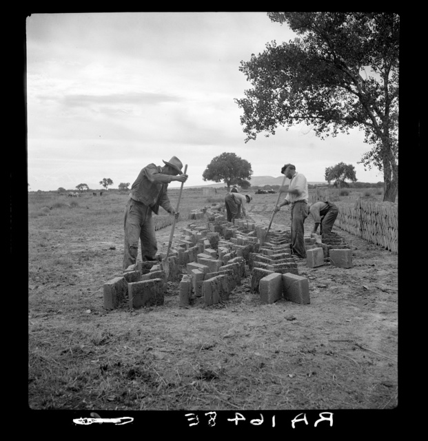 Making adobe bricks. Bosque Farms project, New Mexico. These bricks are to be used in construction of the new school building