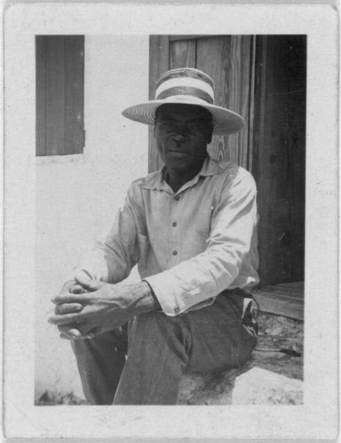 [Man sitting in doorway, possibly from the visit by Alan Lomax and Mary Elizabeth Barnicle to Andros Island in the Bahamas]