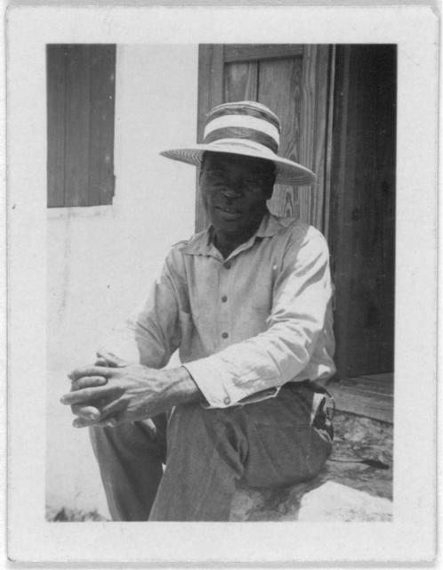 [Man sitting in doorway, possibly taken during the visit by Alan Lomax and Mary Elizabeth Barnicle to Andros Island in the Bahamas]