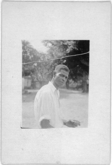 [Man standing, facing right, Eatonville, Fla., taken during the Lomax, Hurston, Barnicle 1935 expedition to Georgia, Florida and the Bahamas]