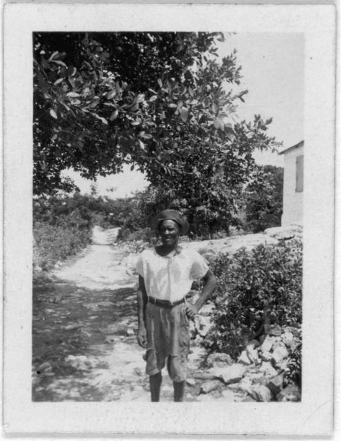 [Man standing next to road, facing front, possibly from the visit by Alan Lomax and Mary Elizabeth Barnicle to Andros Island in the Bahamas]