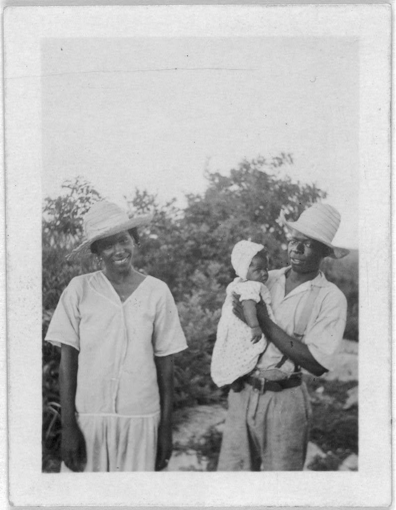 [Man, woman and child standing, facing front, possibly from the visit by Alan Lomax and Mary Elizabeth Barnicle to Andros Island in the Bahamas]