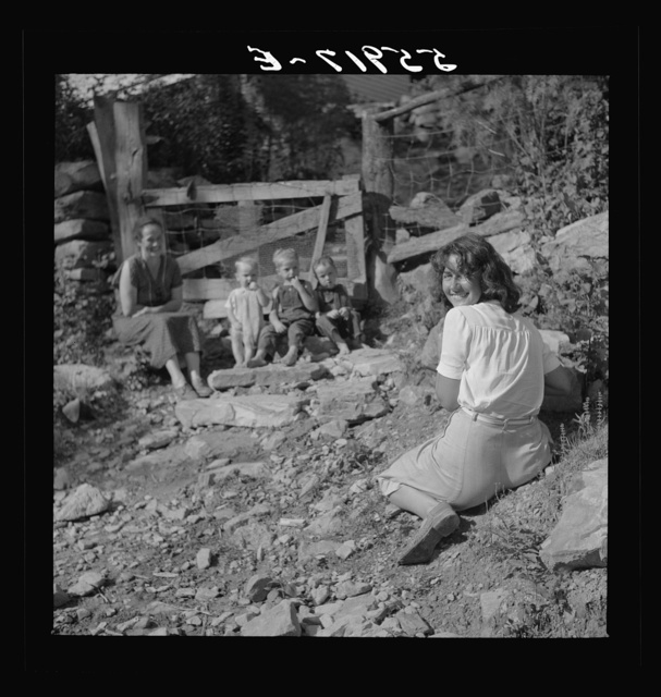 [Marion Post photographing mountain children on stone steps of their home. Up Stinking Creek, Pine Mountain, Kentucky]