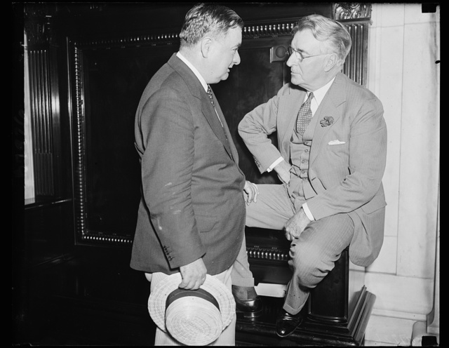 May get graft quiz order. Joseph B. Keehan, Assistant Attorney General, left, talks with Sen. Royal S. Copeland, D. of N.Y., at the Senate Commerce Committee which is hearing the graft charges of Ewing Y. Mitchell, ousted Assistant Secretary of Commerce, who wants the G-men to carry on the investigation of alleged improprieties in the Commerce Department. 6/19/35
