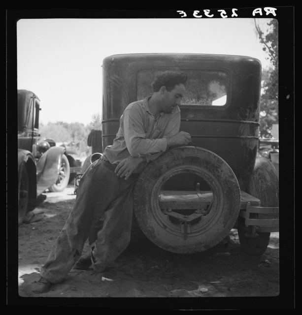 Migrant agricultural worker in Marysville migrant camp (trying to figure out his year's earnings). California