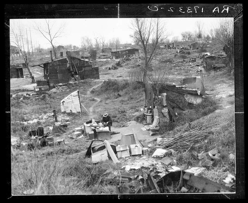 Migrant workers' camp, outskirts of Marysville, California. The new migratory camps now being built by the Resettlement Administration will remove people from unsatisfactory living conditions such as these and substitute at least the minimum of comfort and sanitation