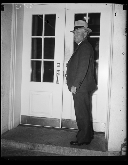 Money man. J.R. McCarl, Comptroller General of the United States, photographed as he called at the White House to be one of the first to see the president upon his return from an extensive vacation. McCarl has been passing upon applications for funds on the WPA program