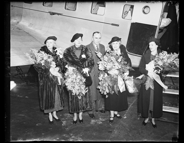 Mrs. Wilson's first flight. Mrs. Woodrow Wilson, widow of the war-time president, completes her first airplane flight. She was in the ship piloted by Capt. Eddie Rickenbacker, who made a dawn-to-dusk flight from New Orleans to New York and return. A stowaway, Miss Marie Reynolds, extreme right, was discovered and treated royally. From the left: Mrs. Eddie Rickenbacker, wife of the flier; Mrs. Eugene Meyer, wife of the publisher; Capt. Rickenbacker, Mrs. Wilson and Miss Reynolds, who was carried aloft as she sought an interview with Capt. Rickenbacker for her school paper. 1/16/35